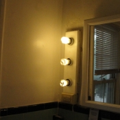 39 A completely rebuilt 1920 light fixture next to the mirror in the second floor bathroom