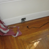 03 Living room outlet removed to reveal knob and tube wiring