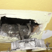 10 An outlet that was hanging out of its box fed by knob and tube wiring