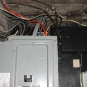14 The electrical panel in the basement. Notice the black box with all the knob and tube wires going to it