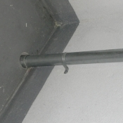 20 A close up of the pipe as it goes to the next floor in a stairwell