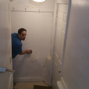 05 Sanding the spackle in the stairs to the basement