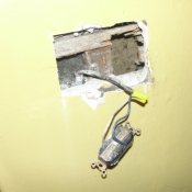 12 An outlet hanging out of the wall in the kitchen without a box-Very dangerous