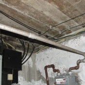 15 Knob and tube wires attached to the ceiling in the basement