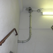 18 A stairwell pipe going to a camera wall bracket