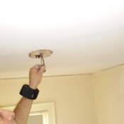 08-Getting the wires ready to cut in a junction box to mount a ceiling light fixture to